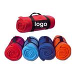 Fleece blanket with nylon carry strap.